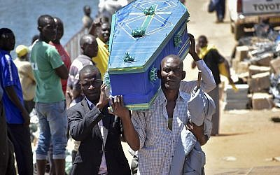 Men carry a coffin for one of the victims of the MV Nyerere passenger ferry on Ukara Island, Tanzania September 22, 2018. (AP Photo)