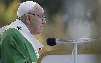 Pope Francis delivers his message as he celebrates Mass at the Santakos Park, in Kaunas, Lithuania, Sunday, Sept. 23, 2018. Francis paid tribute Sunday to Lithuanians who suffered and died during Soviet and Nazi occupations on the day the country remembers the near-extermination of its centuries-old Jewish community during the Holocaust. (AP Photo/Andrew Medichini)