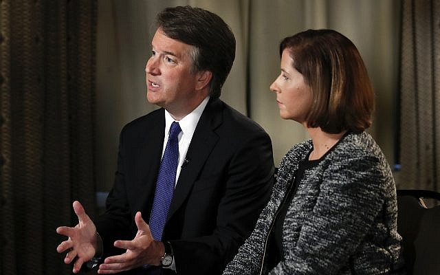 Brett Kavanaugh, with his wife Ashley Estes Kavanaugh, answers questions during a FOX News interview, Monday, September 24, 2018, in Washington, about allegations of sexual misconduct against the Supreme Court nominee. (AP Photo/Jacquelyn Martin)