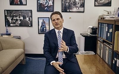 Head of the UN agency for Palestinian refugees, Pierre Krahenbuhl, speaks with a reporter during an interview with AP on September 27, 2018, in New York. (AP/Andres Kudacki)