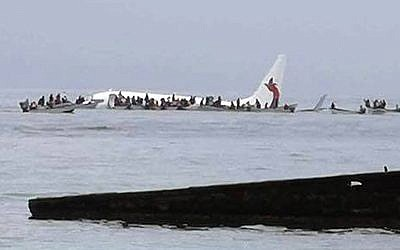 This photo provided by Blue Flag Construction shows an Air Niugini plane floating in Pacific lagoon after its crash-landing in Pacific lagoon near Chuuk Airport in Weno, Federated States of Micronesia, September 28, 2018. (Blue Flag Construction via AP)