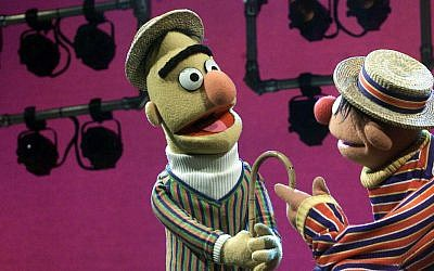 Long time pals Bert, left, and Ernie argue with each other as always on August 22, 2001, during an interview in New York (AP Photo/Beth A. Keiser)