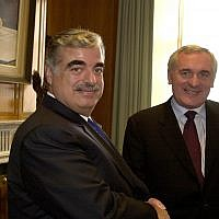 The Prime Minister of Lebanon Rafik Hariri, left, is greeted by Bertie Ahern, the Irish Prime Minister for talks at Government Buildings, Dublin, Monday, April 26, 2004. (AP photo/John Cogill)