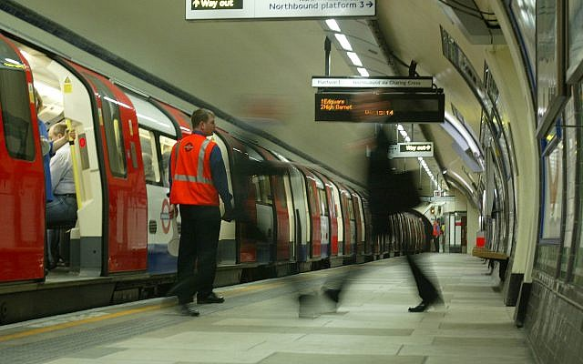 Illustrative: Rush hour passenger walks along an empty platform at Kennington Tube Station  in London, Friday, July 8, 2005 (AP Photo/Sergio Dionisio)