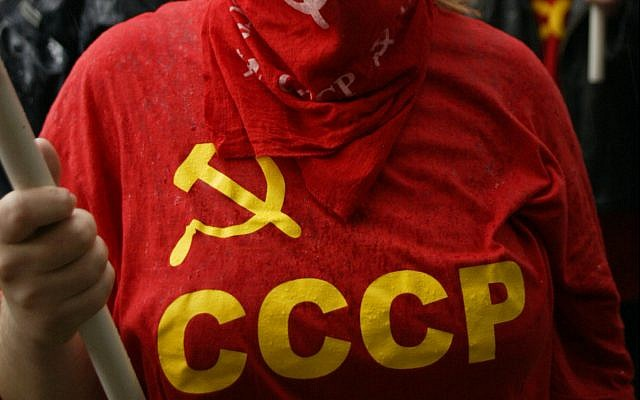 Illustrative: A red T-shirt with the acronym and symbol of the former Soviet Union. (AP Photo/Misha Japaridze)