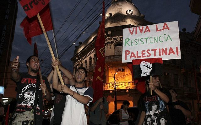 Demonstrators shout slogans against Israel's military strikes on the Gaza Strip during a protest in Asuncion, Paraguay, Friday, January 9, 2009. (AP/Rene Gonzalez)