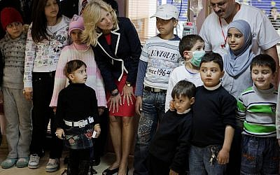 Illustrative: Dr. Jill Biden, wife of then-US vice president Joseph Biden, seen with Palestinian patients during a visit to the Augusta Victoria Hospital in East Jerusalem, on March 10, 2010. (AP/Menahem Kahana, Pool)