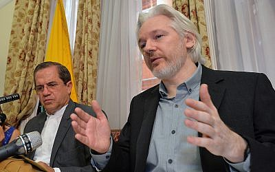 Ecuador's Foreign Minister Ricardo Patino, left, and WikiLeaks founder Julian Assange speak during a news conference inside the Ecuadorian Embassy in London, August 18, 2014. (John Stillwell/Pool Photo via AP)