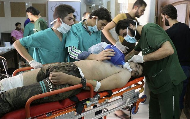 Illustrative: This Tuesday, Sept. 6, 2016 photo, provided by the Syrian anti-government activist group Aleppo Media Center (AMC), shows medical staff treating a man suffering from breathing difficulties inside a hospital in Aleppo, Syria (Aleppo Media Center via AP)