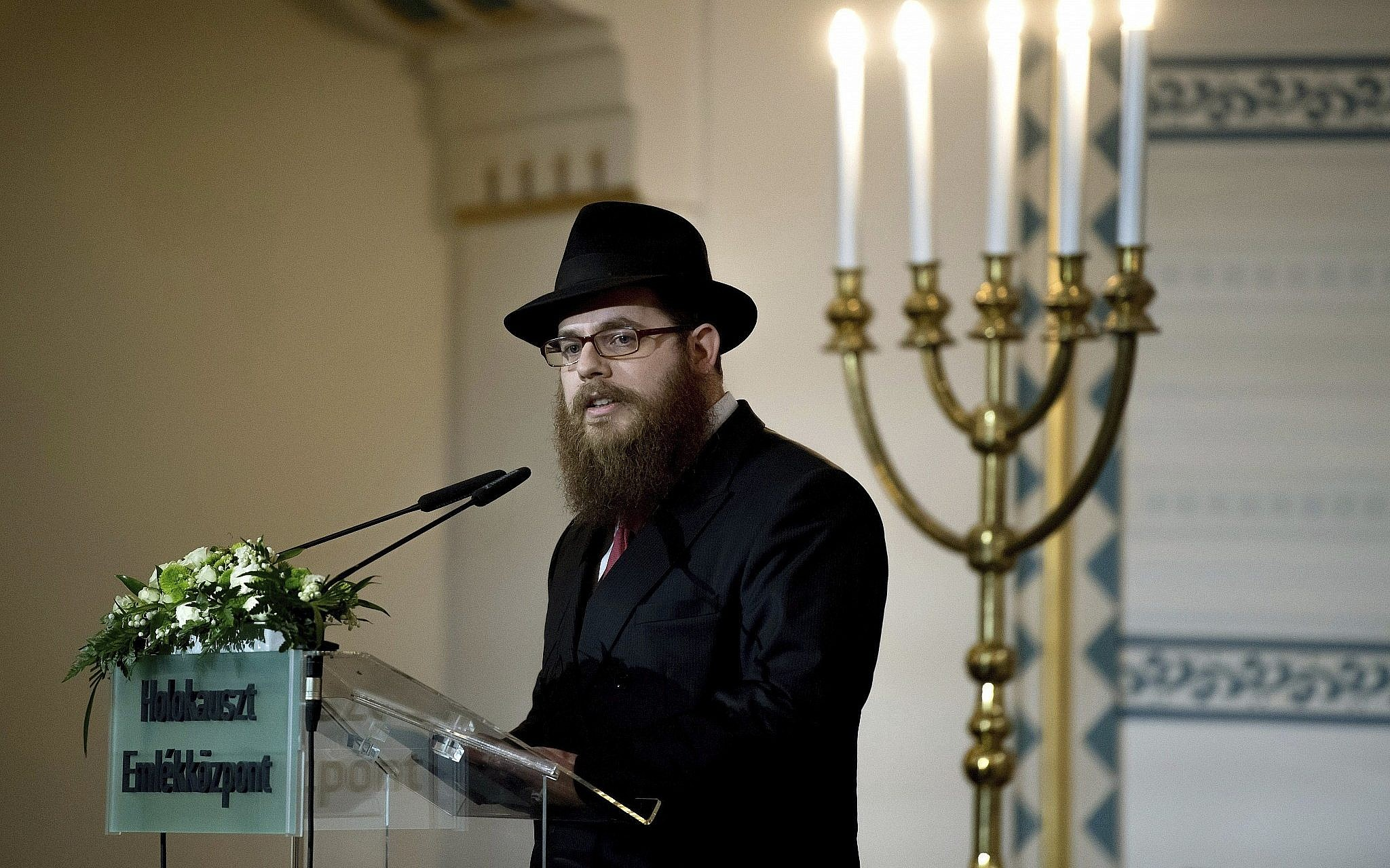 Slomo Koves, chief rabbi of the Chabad-affiliated Unified Israelite Congregation of Hungary (EMIH), speaks during a commemoration marking the Memorial Day of the Hungarian Holocaust victims in the Holocaust Memorial Center in Budapest, Hungary, on April 19, 2017. (Szilard Koszticsak/MTI via AP)