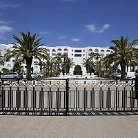Guards stand in the Tunisian hotel where foreign tourists were massacred in 2015, as it reopens Tuesday May 2, 2017 in Sousse.  (AP Photo/Sami Boukef)