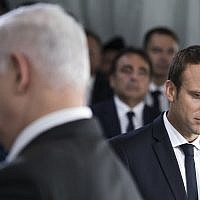 Israeli Prime Minister Benjamin Netanyahu, left, and French President Emmanuel Macron attend a ceremony commemorating the 75nd anniversary of the Vel d'Hiv roundup, Sunday, July 16, 2017 in Paris. (AP Photo/Kamil Zihnioglu, Pool)