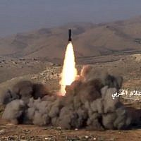 This frame grab from video released on July 22, 2017, and provided by the government-controlled Syrian Central Military Media, shows Hezbollah fighters firing a missile at positions of al-Qaeda-linked militants in an area on the Lebanon-Syria border. (Syrian Central Military Media, via AP)