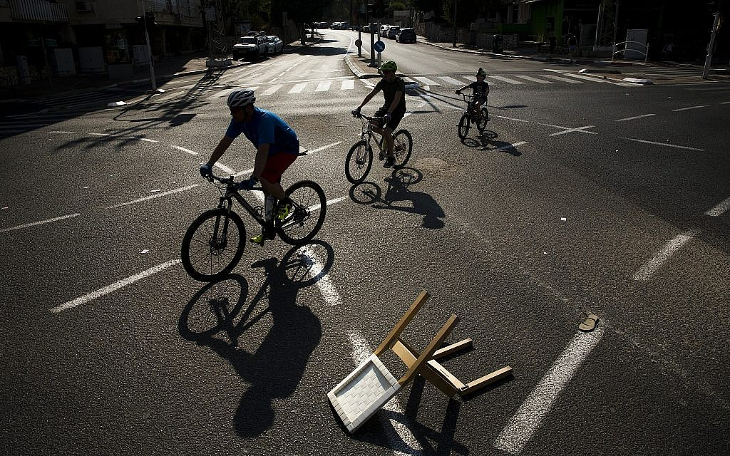 People ride their bicycles on a car-free street during Yom Kippur in Ramat Gan, Israel, Sept. 30, 2017. (AP Photo/Oded Balilty)