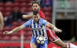 Tomer Hemed, foreground, then on Brighton & Hove Albion, is challenged by Middlesbrough's Ryan Shotton during the FA Cup, fourth round match between Brighton and Middlesbrough, at the Riverside Stadium, Middlesbrough, England, on January 27, 2018. (Owen Humphreys/PA via AP)