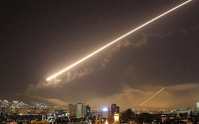 In this April 14, 2018 file photo, Damascus skies erupt with surface to air missile fire as the U.S. launches an attack on Syria targeting different parts of the Syrian capital Damascus, Syria. (AP/Hassan Ammar)