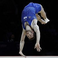 Artem Dolgopyat of Israel performs in the floor exercise during the men's artistic gymnastics finals at the European Championships in Glasgow, Scotland, August 12, 2018. (AP Photo/ Darko Bandic/File)