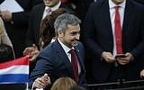 Paraguay's newly-elected President Mario Abdo Benitez greets the crowd during his arrival at his inauguration ceremony at 'Lopez Palace' in Asuncion, Paraguay, on August 15, 2018. (AP Photo/Jorge Saenz)