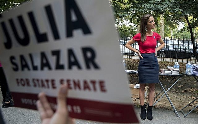 In this Wednesday, August 15, 2018 photo, a supporter holds a sign for Democratic New York State Senate candidate Julia Salazar as she appears at a rally in McCarren Park in the Brooklyn borough of New York. (AP /Mary Altaffer)