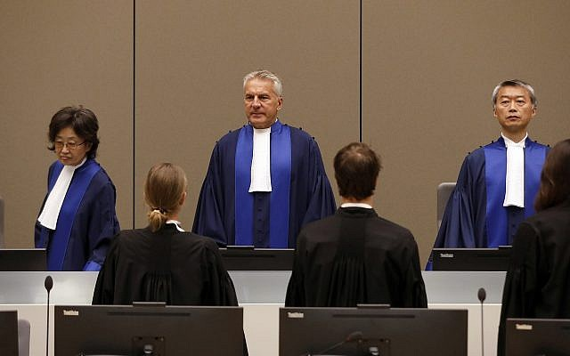Illustrative: Presiding Judge Robert Fremr, center, stands in the courtroom of the International Criminal Court (ICC) during the closing statements of the trial of Bosco Ntaganda, a Congo militia leader, in The Hague, Netherlands, Tuesday Aug. 28, 2018. (Bas Czerwinski/Pool via AP)