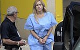 In this September 24, 2015 photo, Aurea Vazquez Rijos, who was accused more than a decade ago of the murder of her husband, the Canadian Adam Anhang, is taken to the Federal Court in Hato Rey, Puerto Rico (Carlos Giusti/El Vocero via AP)