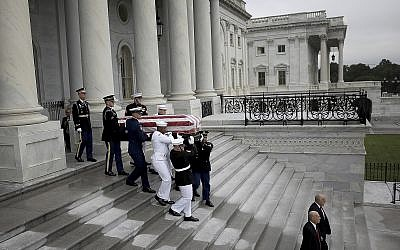A military honor guard team carries the casket of Sen. John McCain from the US Capitol, Saturday, Sept. 1, 2018 in Washington. (Win McNamee/Pool photo via AP)
