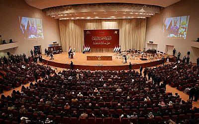 Iraqi lawmakers attend the first parliament session in Baghdad, Iraq, Sept. 3, 2018. (AP Photo/Karim Kadim)