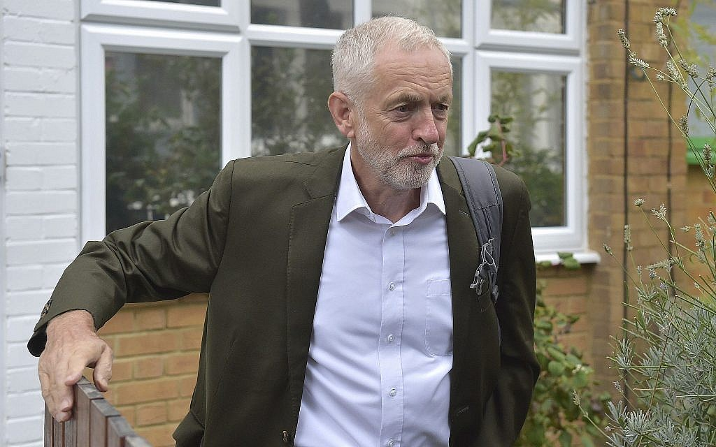 Britain's Labour party leader Jeremy Corbyn leaves his house in London ahead of a meeting of the party's National executive Committee, in London, Tuesday Sept. 4, 2018 (Nick Ansell/PA via AP)