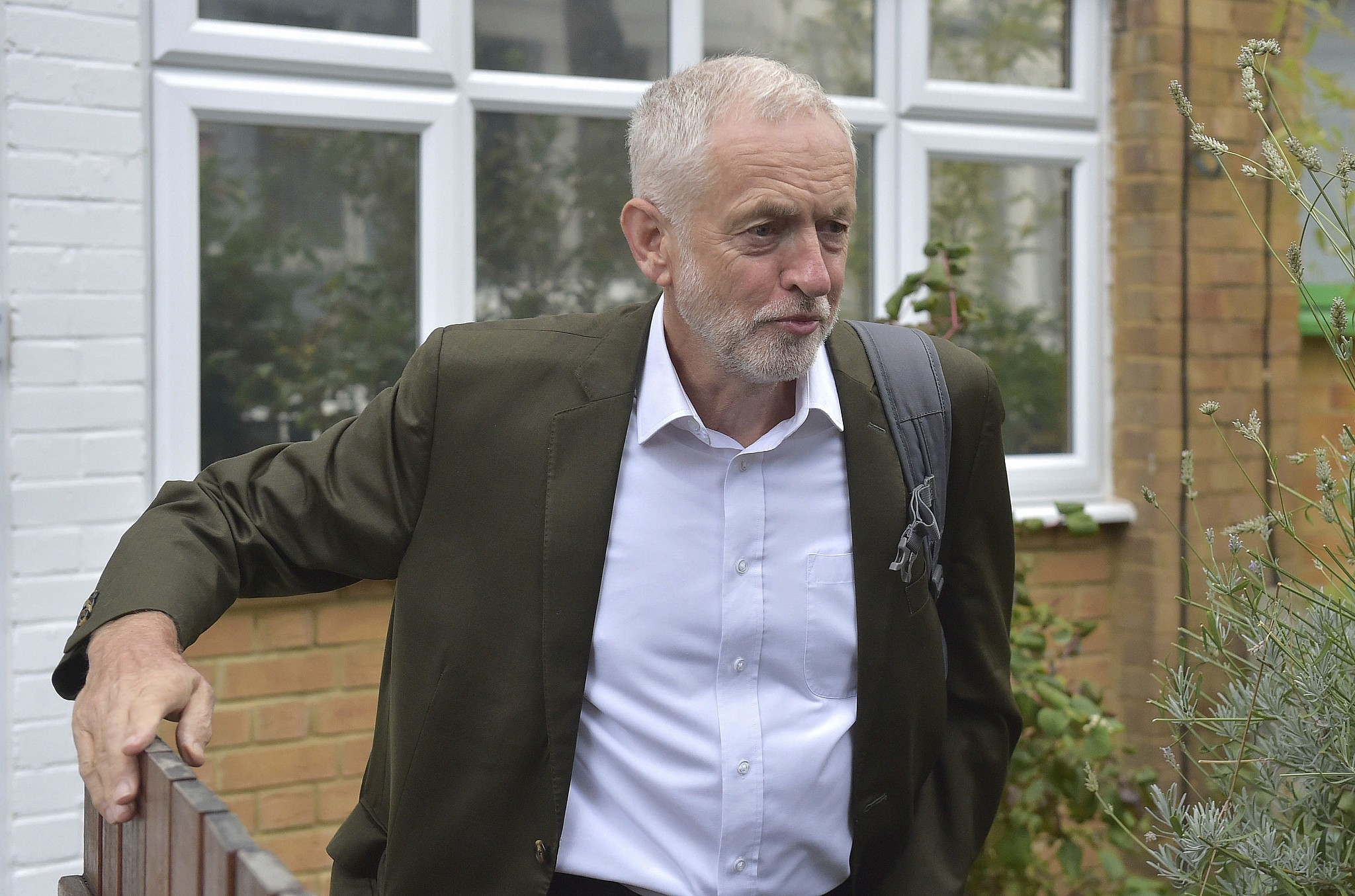98d0420953ed5e Britain s Labour party leader Jeremy Corbyn leaves his house in London  ahead of a meeting of