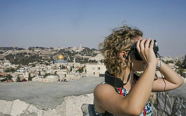 In this Monday, Sept. 3, 2018 photo, released by the Tower of David Museum, a visitor uses goggles on a new virtual reality tour that allows visitors to experience how archaeologists believe Jerusalem looked 2,000 years ago (Tomer Zmora/Tower of David Museum via AP)