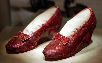This April 10, 1996, file photo shows one of the four pairs of ruby slippers worn by Judy Garland in the 1939 film 'The Wizard of Oz' on display during a media tour of the 'America's Smithsonian' traveling exhibition in Kansas City, Missouri (AP Photo/Ed Zurga, File)