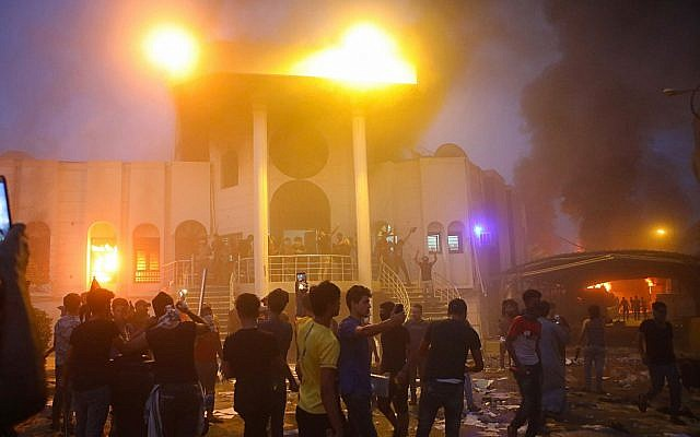 Protesters storm and burn the Iranian consulate building during anti-government protests in the southern Iraqi city of Basra on September 7, 2018. (AP/Nabil al-Jurani)