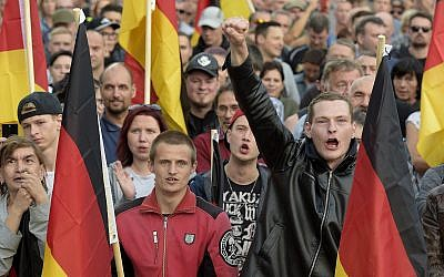 People attend a far-right demonstration in Chemnitz, eastern Germany, September 7, 2018 (AP Photo/Jens Meyer)