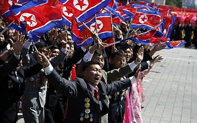 Participants cheer as they take part in a parade marking the 70th anniversary of North Korea's founding day in Pyongyang, North Korea, Sunday, Sept. 9, 2018. (AP Photo/Ng Han Guan)
