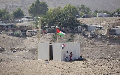 Palestinians girls sit by newly made shed in the West Bank Bedouin community of Khan al-Ahmar, September 11, 2018 (AP Photo/Majdi Mohammed)