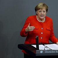 German Chancellor Angela Merkel delivers her speech during a plenary session of the German parliament Bundestag about the budget 2019, in Berlin, September 12, 2018. (AP Photo/Markus Schreiber)
