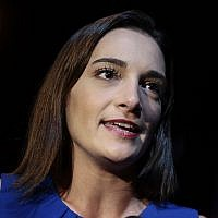 Julia Salazar answers questions during an interview after winning the Democratic primary over Martin Dilan in New York's 18th State Senate district race, on September 13, 2018, in New York. (AP Photo/Julie Jacobson)