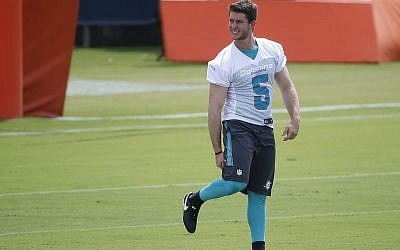 In this May 30, 2018, file photo, kicker Greg Joseph warms up during an NFL organized team activities football practice at the Miami Dolphins training facility in Davie, Fla. (AP Photo/Wilfredo Lee, )