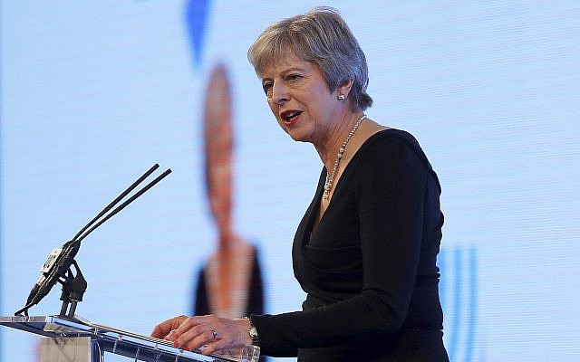Britain's Prime Minister Theresa May speaks at the United Jewish Israel Appeal charity dinner in London, Sept. 17, 2018. (Peter Nicholls/Pool via AP)