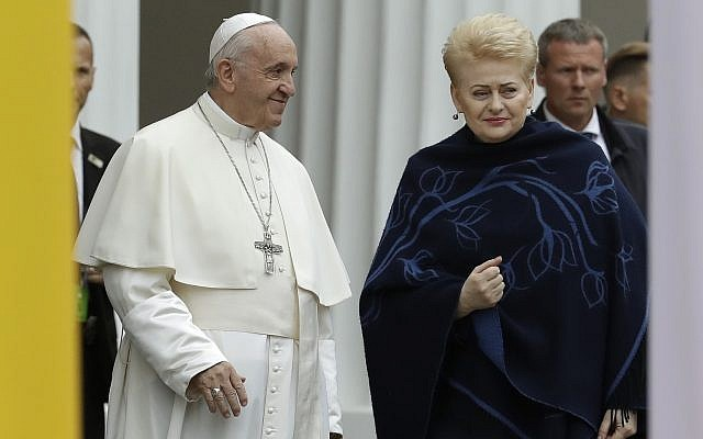 Pope Francis smiles as he arrives with Lithuanian President Dalia Grybauskaite, right, ahead of a meeting with authorities, civil society and diplomatic corps in the square in front of the Presidential Palace, in Vilnius, Lithuania, Sept. 22, 2018 (AP Photo/Andrew Medichini)