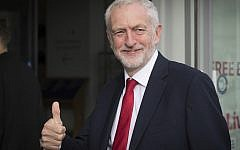 Britain's main opposition Labour Party leader Jeremy Corbyn gives a thumbs up gesture as he arrives for an interview by BBC TV journalist Andrew Marr, in Liverpool, England, Sept. 23, 2018 (Stefan Rousseau/PA via AP)