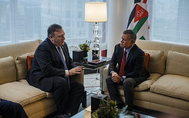 Secretary of State Mike Pompeo, left, talks to Jordan's King Abdullah II bin Al-Hussein, right, during a meeting at Mandarin Oriental Hotel, in New York, Sept. 23, 2018, in New York. (Andres Kudacki via AP, Pool)