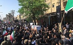 Mourners carry a casket during a mass funeral for those who died in a terror attack on a military parade in Iran in Ahvaz, Iran, Sept. 24, 2018 (AP Photo/Ebrahim Noroozi)