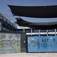 A painting adorns a wall at a closed United Nations Relief and Works Agency (UNRWA) school during a general strike by UN staff, in Gaza City, Sept. 24, 2018. (AP Photo/Khalil Hamra)