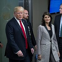 President Donald Trump addresses arrives with Nikki Haley, the US ambassador to the UN, during the 73rd session of the United Nations General Assembly, at UN headquarters, Sept. 25, 2018. (AP Photo/Craig Ruttle)