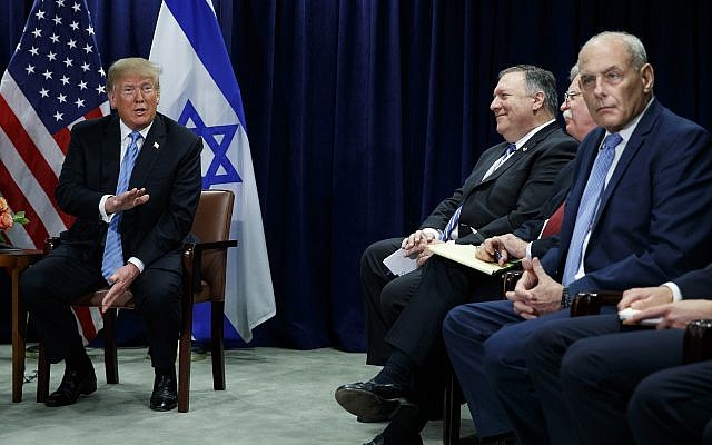 US President Donald Trump speaks during a meeting with Prime Minister Benjamin Netanyahu at the United Nations General Assembly, September 26, 2018, at UN Headquarters. At right are Secretary of State Mike Pompeo, National Security Adviser John Bolton and White House Chief of Staff John Kelly. (AP Photo/Evan Vucci)