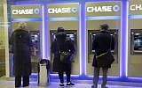 Customers using ATM machines at a branch of Chase Bank in New York, January 14, 2015. (AP/Mark Lennihan)
