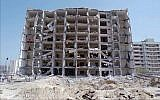 This June 30,1996 photo, show a general view of the destroyed Khobar Towers and crater where a truck bomb exploded at a US military complex killing 19 Americans and injuring hundreds in Dhahran, Saudi Arabia. (AP Photo/Saleh Rifai)