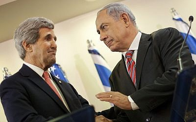 U.S. Secretary of State John Kerry, left, and Israeli Prime Minister Benjamin Netanyahu shakes hands during their joint statement at the prime minister's office in Jerusalem, Thursday, Dec. 5, 2013. (AP Photo/Pablo Martinez Monsivais, Pool)