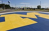 A University of Michigan logo decorates a roundabout on the school's campus in Ann Arbor, Michigan, on July 20, 2015. (AP/Paul Sancya)